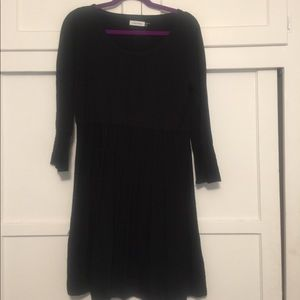 Black sweater dress with quarter length sleeves